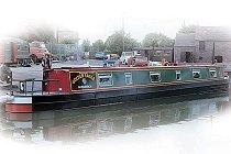 Bild på Gull kanalbåt i England